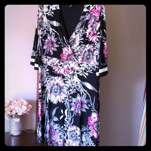 Gorgeous floral dress with asymmetrical hemline